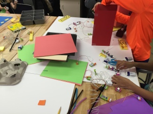 Students work with littleBits to create a city.